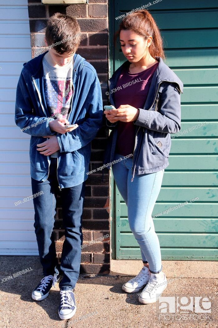 Stock Photo: Teenagers chatting near flats.