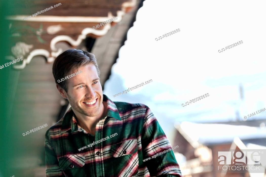 Stock Photo: Man laughing on cabin porch.