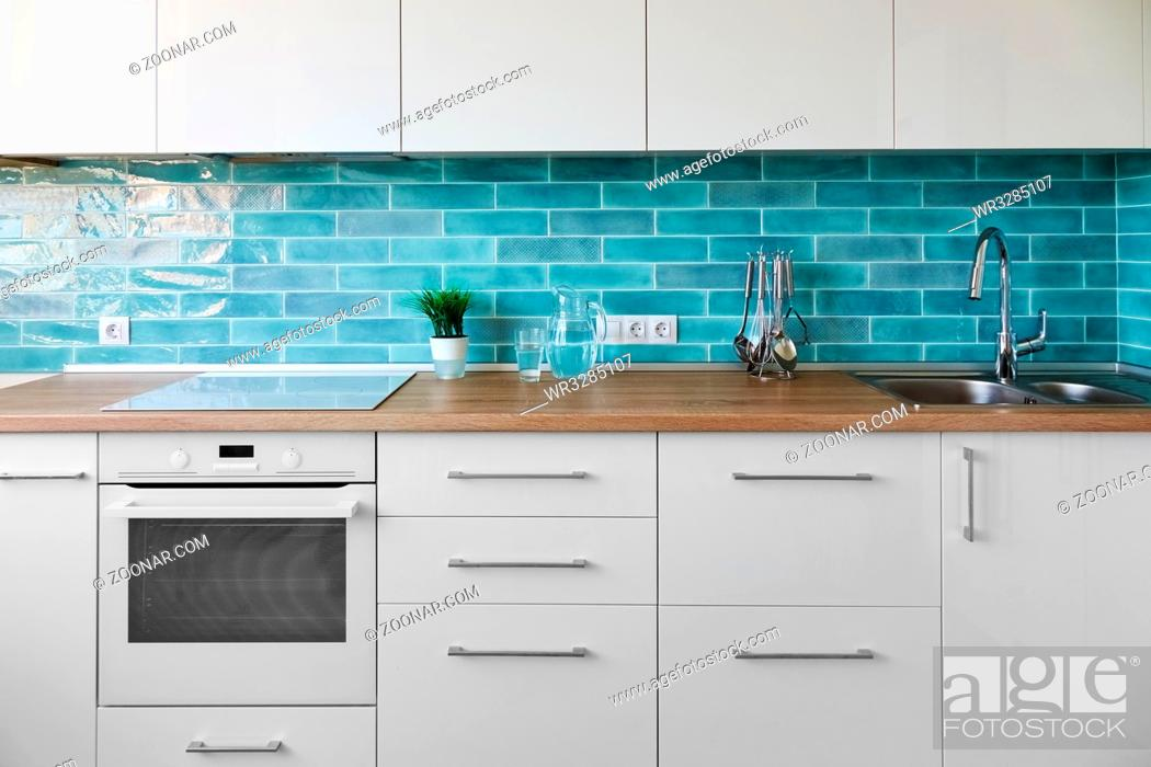 White Kitchen In Modern Style With Accessories On A Background Of Blue Tiles Stock Photo Picture And Royalty Free Image Pic Wr3285107 Agefotostock