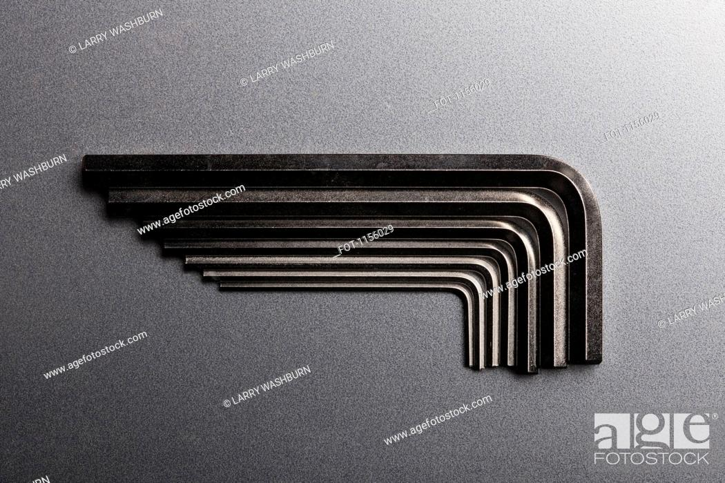 Stock Photo: Various sizes of Allen wrenches fitted into each other.