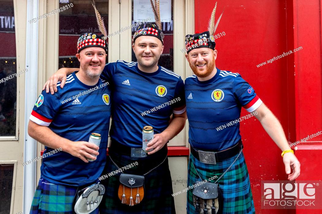 Stock Photo: ***MALE NUDITY PIXELATED*** Scottish Football Fans in Leicester Sq ahead of tonights Euros game against England Featuring: Atmosphere Where: London.