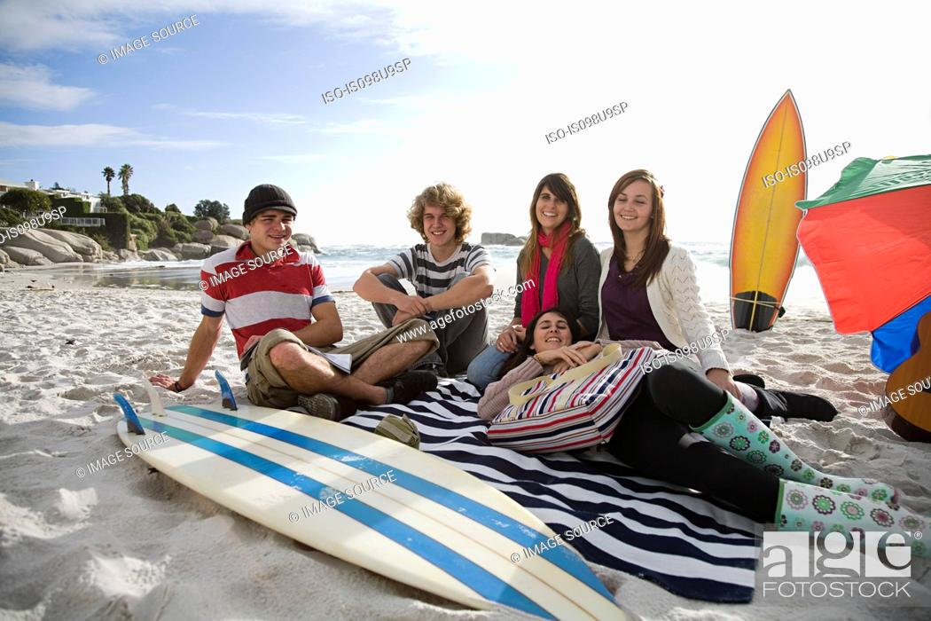 Stock Photo: Friends on beach with surfboard.