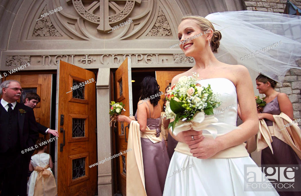 Stock Photo: Bride with veil waiting outside of church.