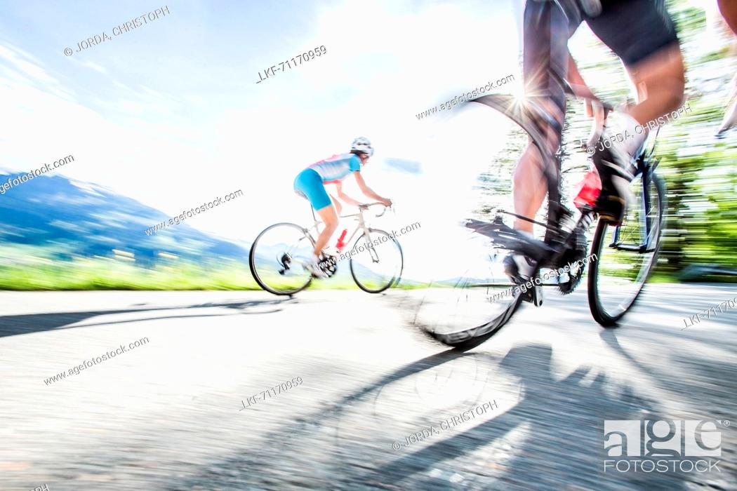 Stock Photo: Two young people on their racing cycles in the Kitzbühler Alps, Kitzbühlerhorn, Tyrol, Austria.