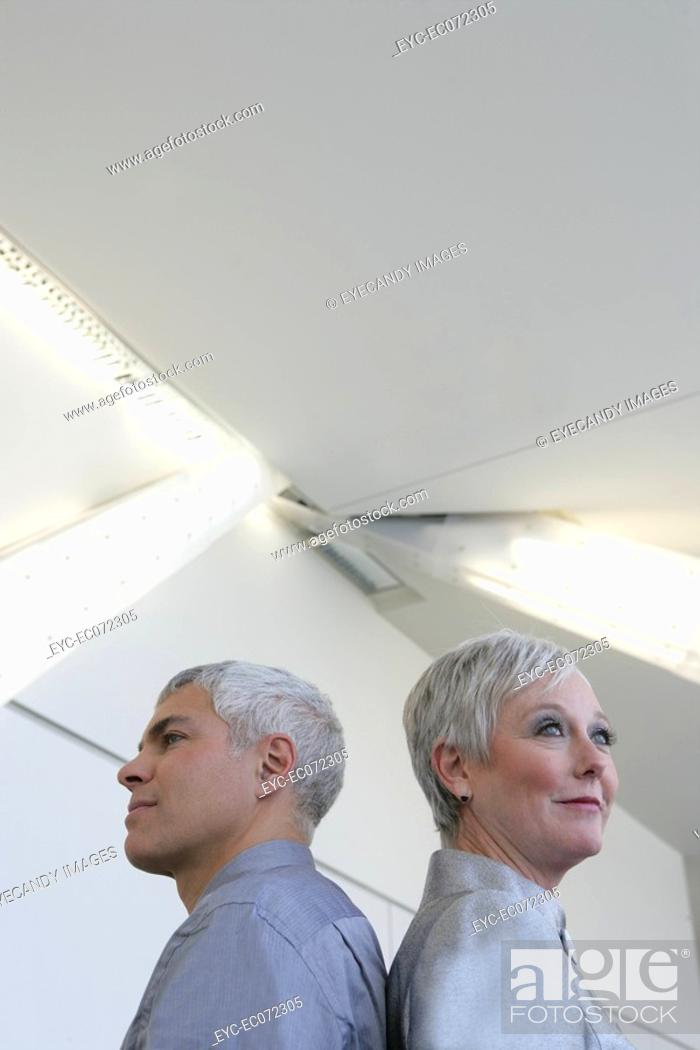 Stock Photo: Mature couple standing in airport.