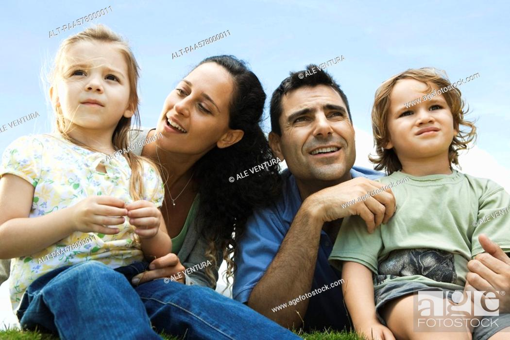 Stock Photo: Family sitting together outdoors.