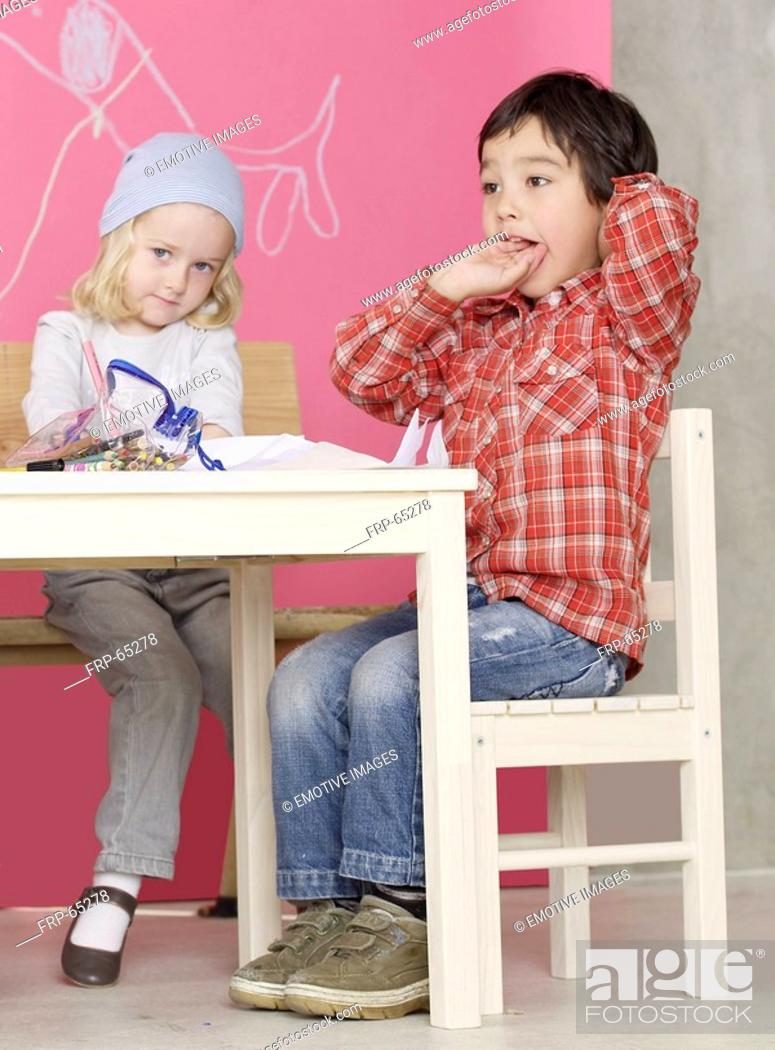 Stock Photo: Girl and boy sitting at the table.