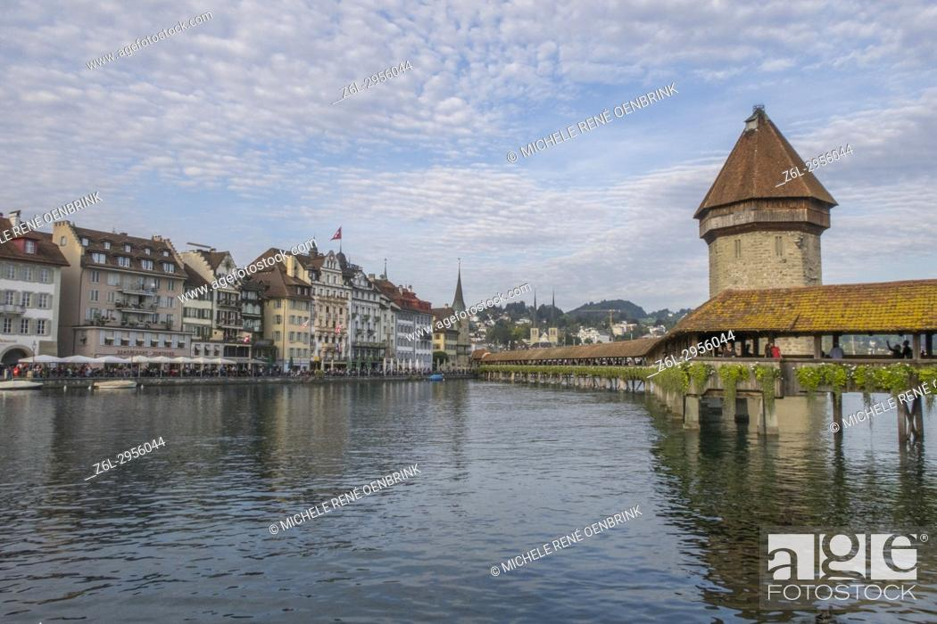 Stock Photo: Lake Lucerne Switzerland famous walking bridge and swans in river during the fall season.