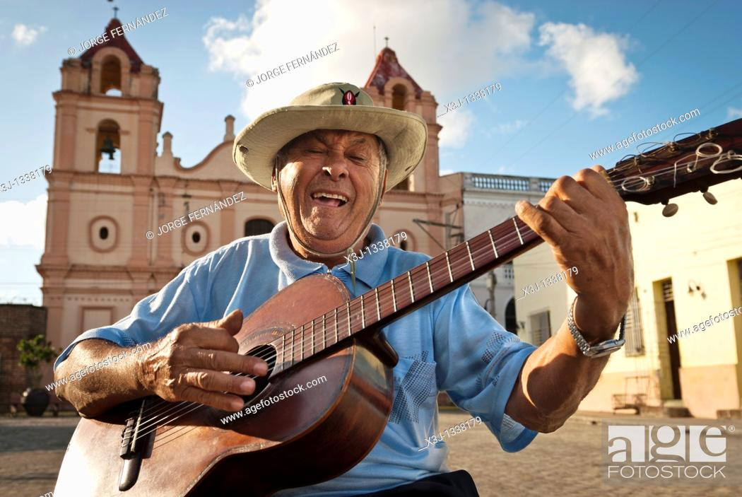 Stock Photo: Man with Spanish guitar singing in 'Plaza del Carmen' , Camaguey, Cuba, Caribbean.