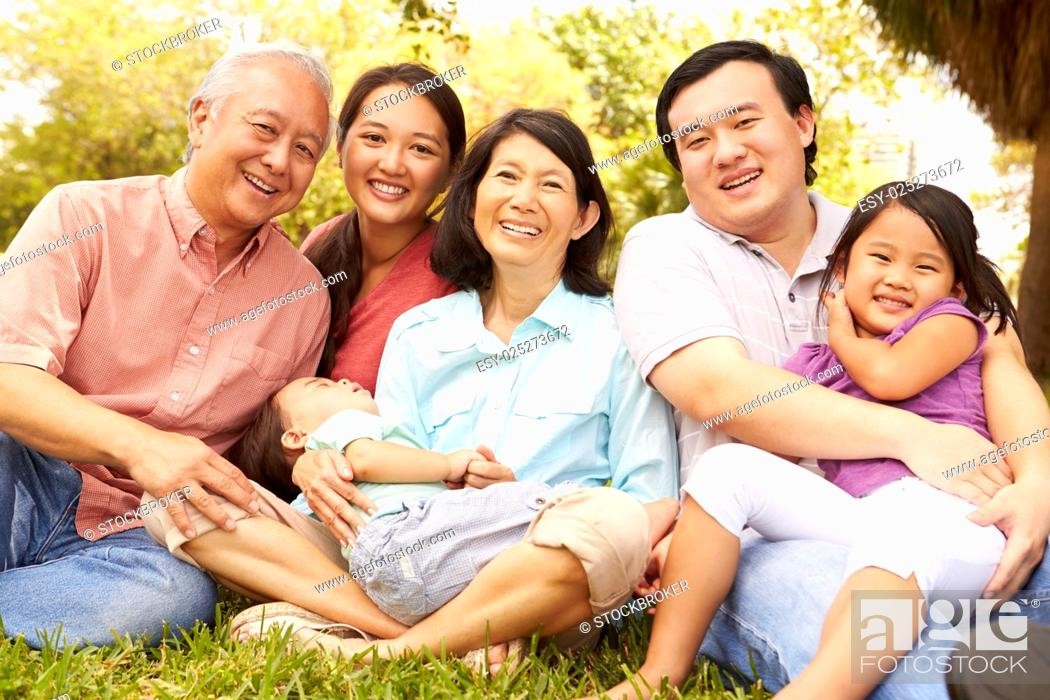 Stock Photo: Multi Generation Family Sitting In Park Together.