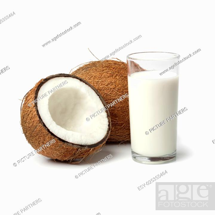 Photo de stock: Coconut with a glass of coconut milk on white background.