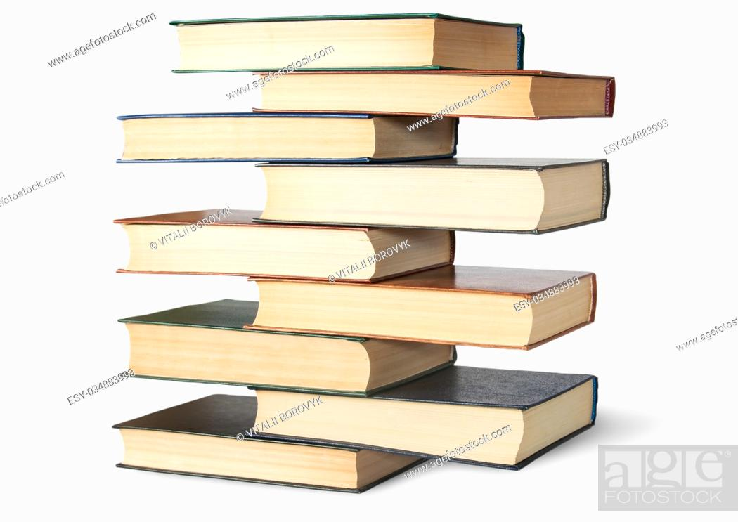 Imagen: Vertical stack in old books rotated isolated on white background.