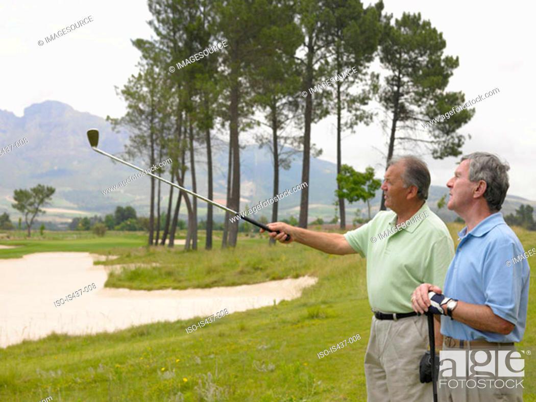 Stock Photo: Senior men on a golf course.
