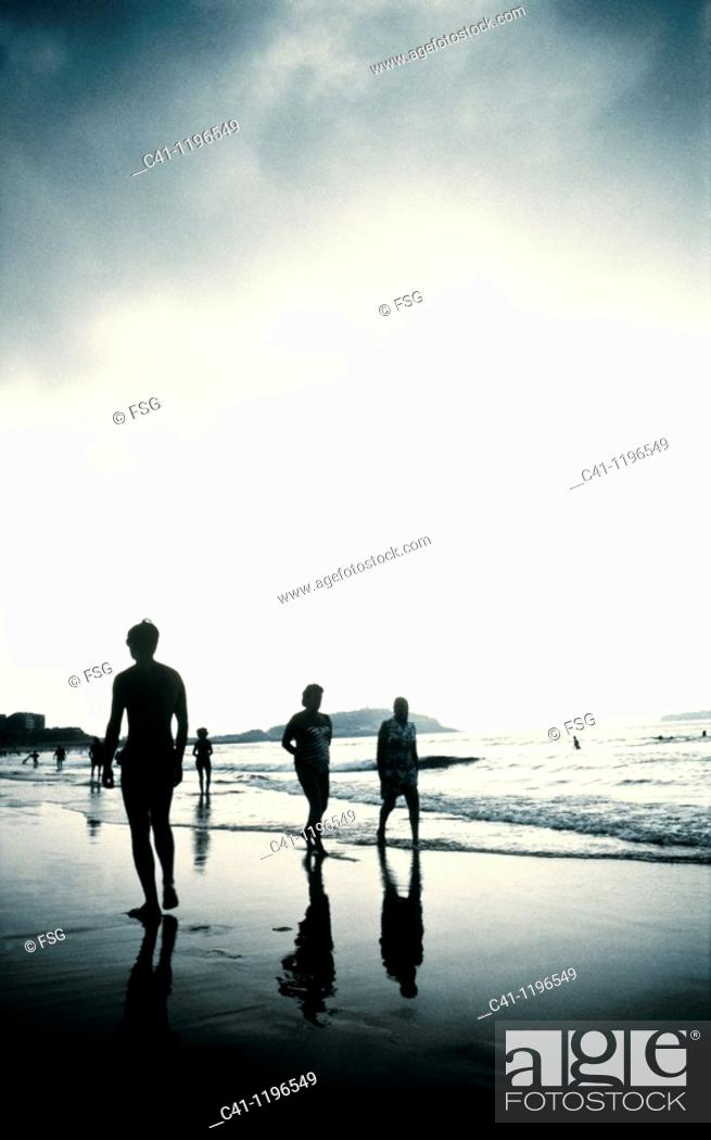 Stock Photo: People in the beach.