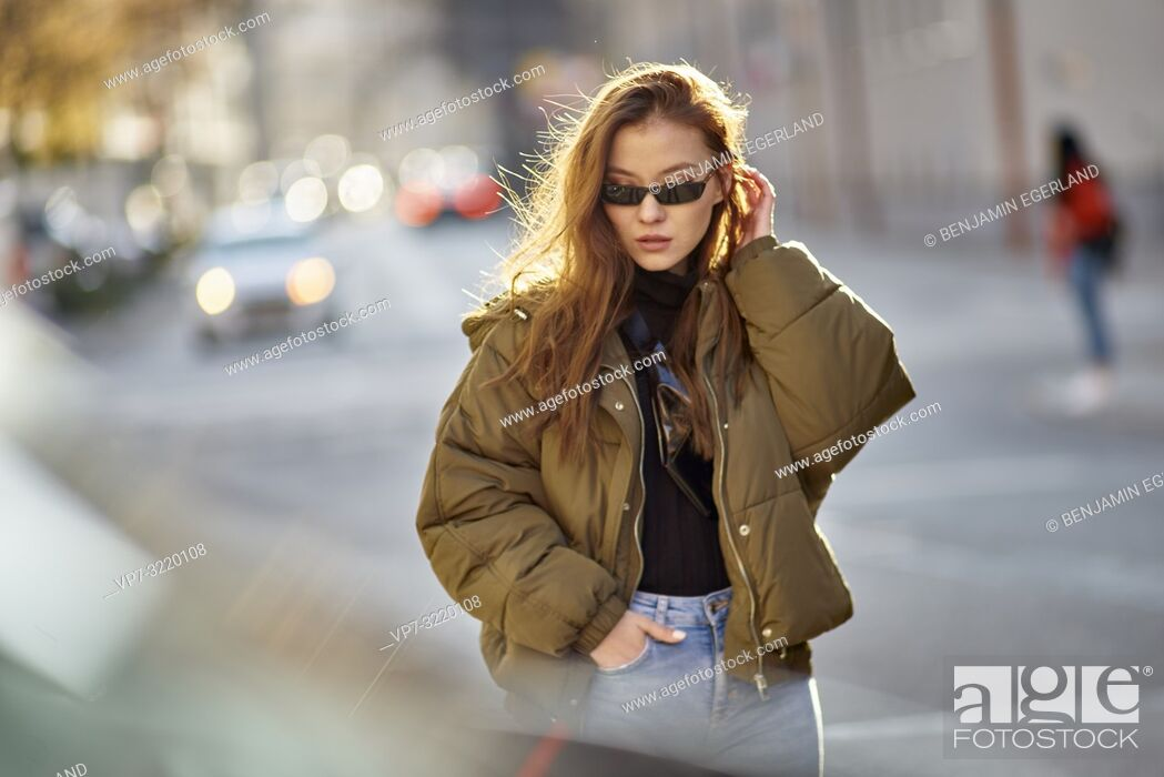 Stock Photo: fashionable blogger woman walking in city streets with cool individual style, in Munich, Germany.