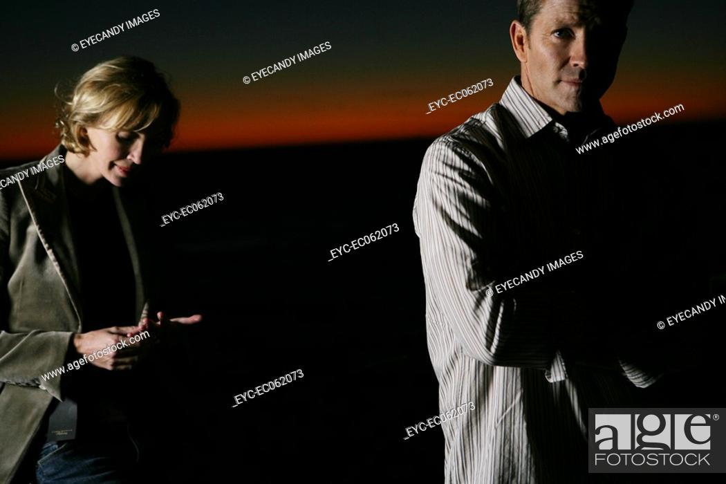 Stock Photo: Mature couple, man looking at camera.