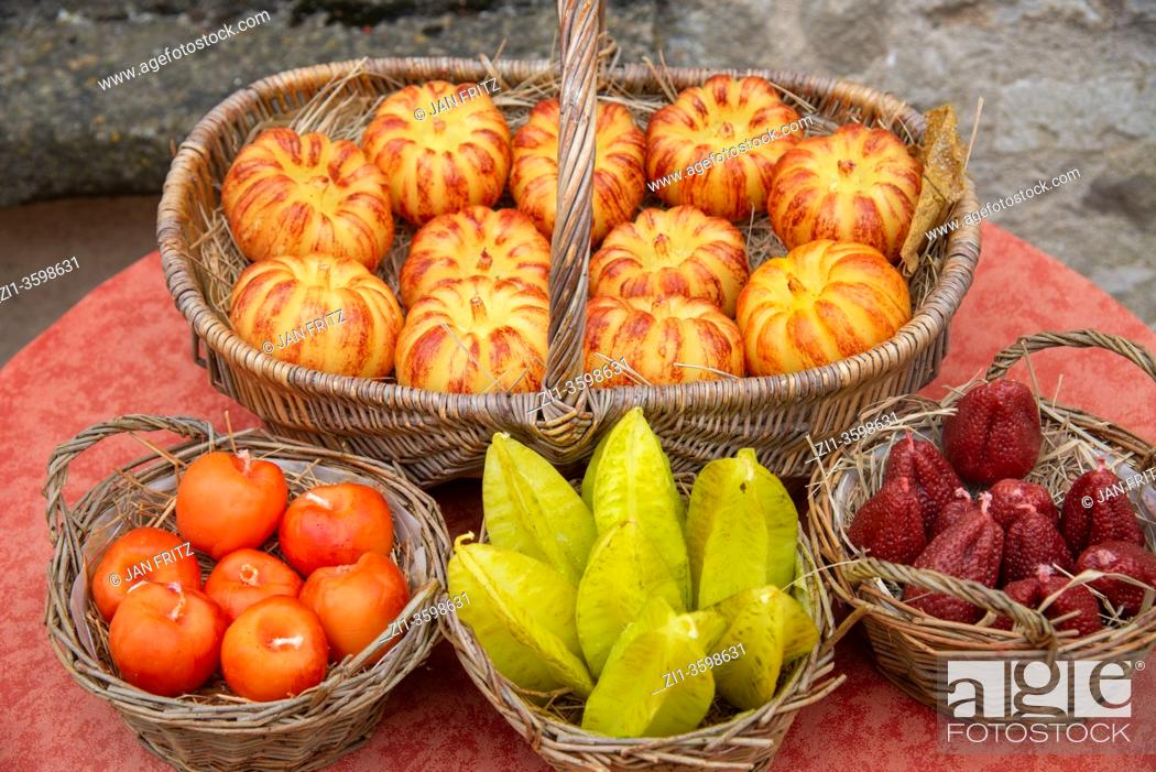 Photo de stock: fruit candles for sale in Vezelay, France.