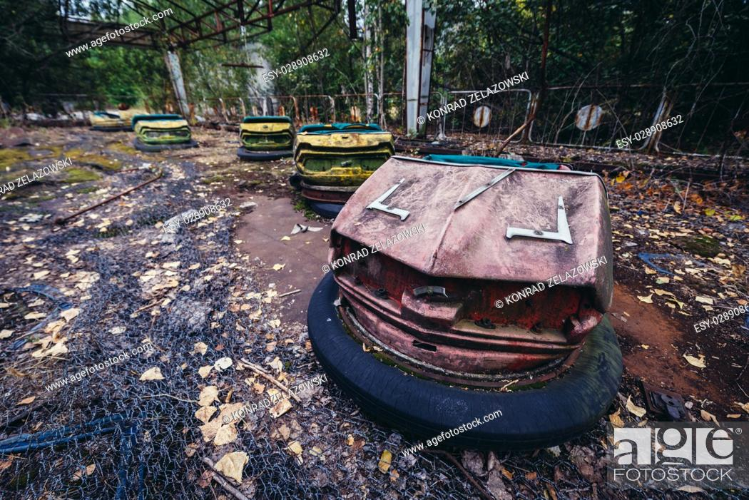 Stock Photo: Bumper cars in amusement park of Pripyat ghost city, Chernobyl Nuclear Power Plant Zone of Alienation around nuclear reactor disaster in Ukraine.