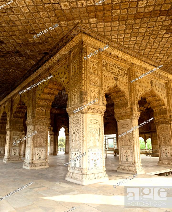 Stock Photo: Ornate pillars and arches in Indian building.