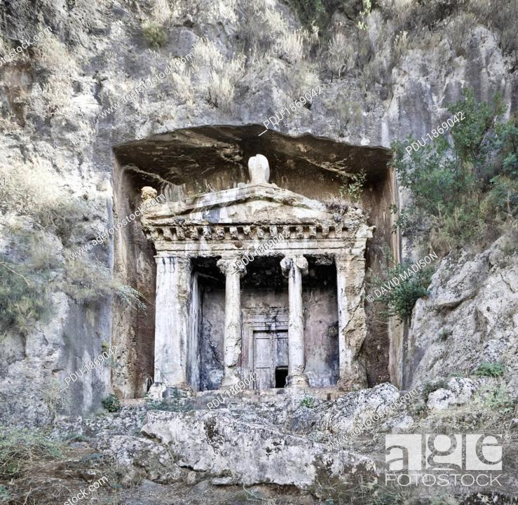 Stock Photo: Lycian temple tombs cut into the cliffs.