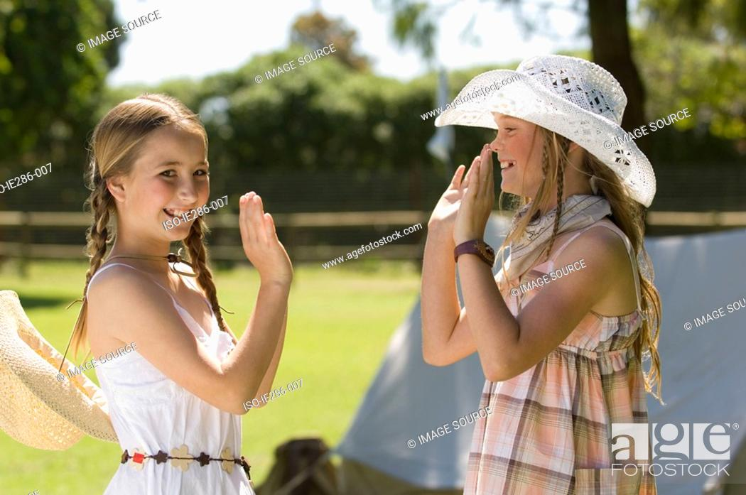 Stock Photo: Two girls playing pat a cake.