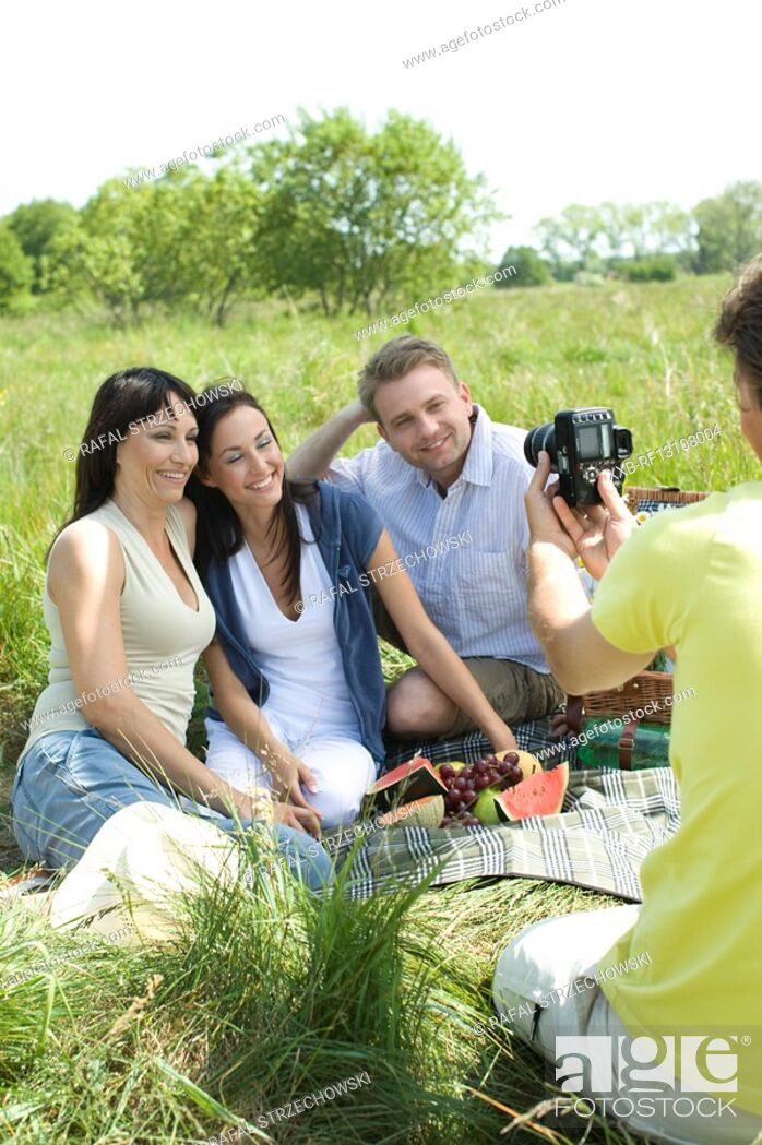 Stock Photo: freinds taking photos on picnic.
