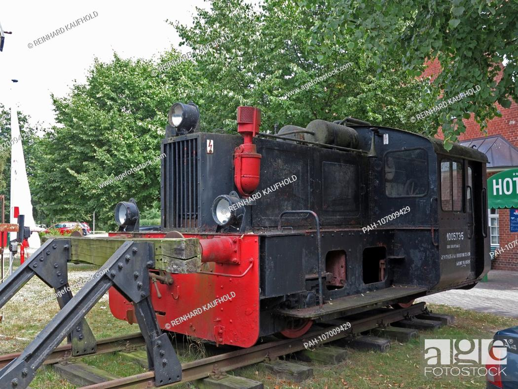 Stock Photo: An old locomotive of the former Darss Railway stands in front of the former station building in Prerow on the Darss, recorded in July 2018 | usage worldwide.