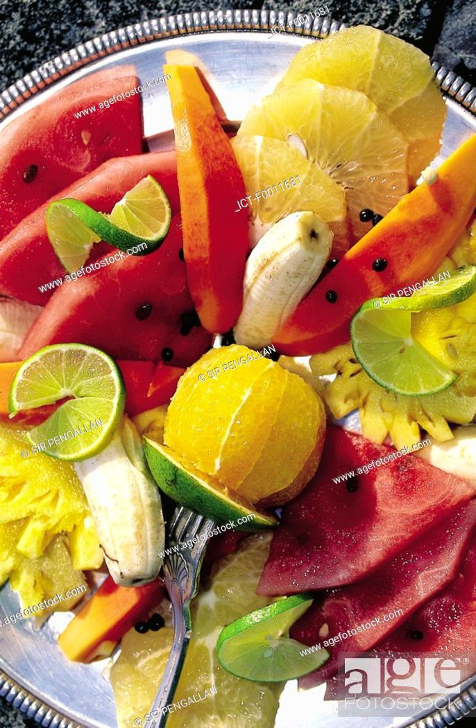 Stock Photo: Jamaica, Port Antonio, plate of tropical fruits.