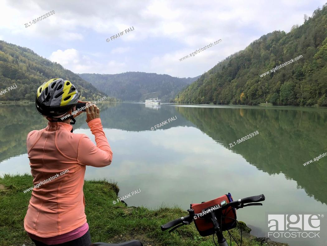 Stock Photo: Tourist taking photo fo cruiseship along the Danube river Germany.