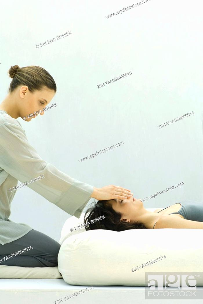 Stock Photo: Woman receiving reiki head massage.