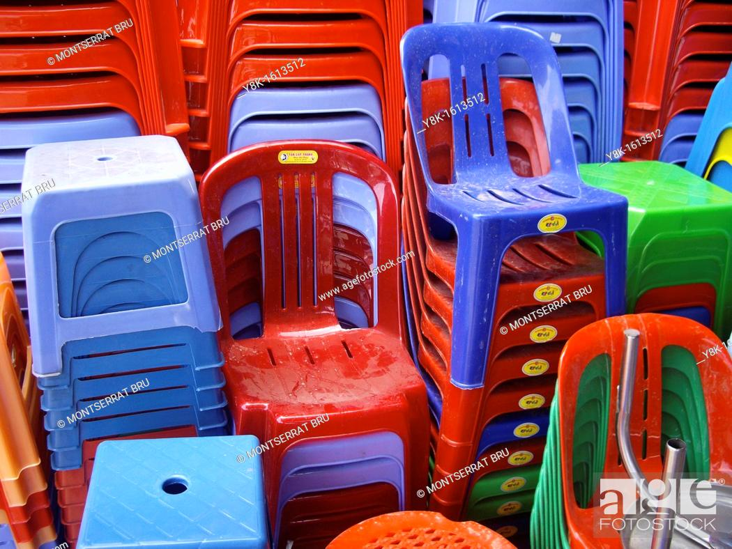 Stock Photo: Coloured plastic chairs and stools at Kampot market, Cambodia.