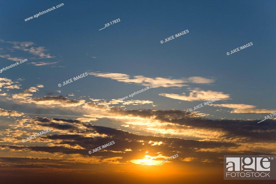 Stock Photo: Clouds in sunset sky.
