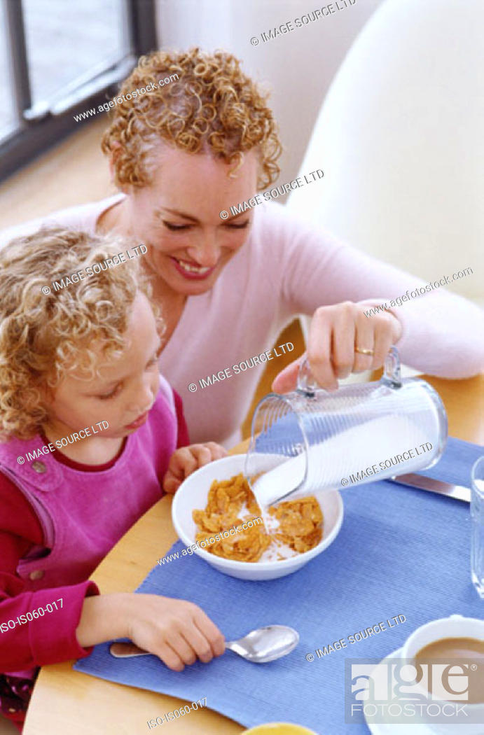Stock Photo: Mother and daughter at breakfast.