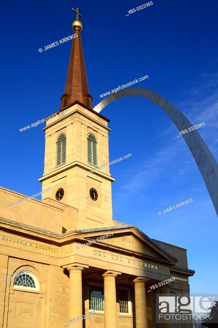 Stock Photo: The Gateway Arch rises behind the St Louis Basilica in St Louis.