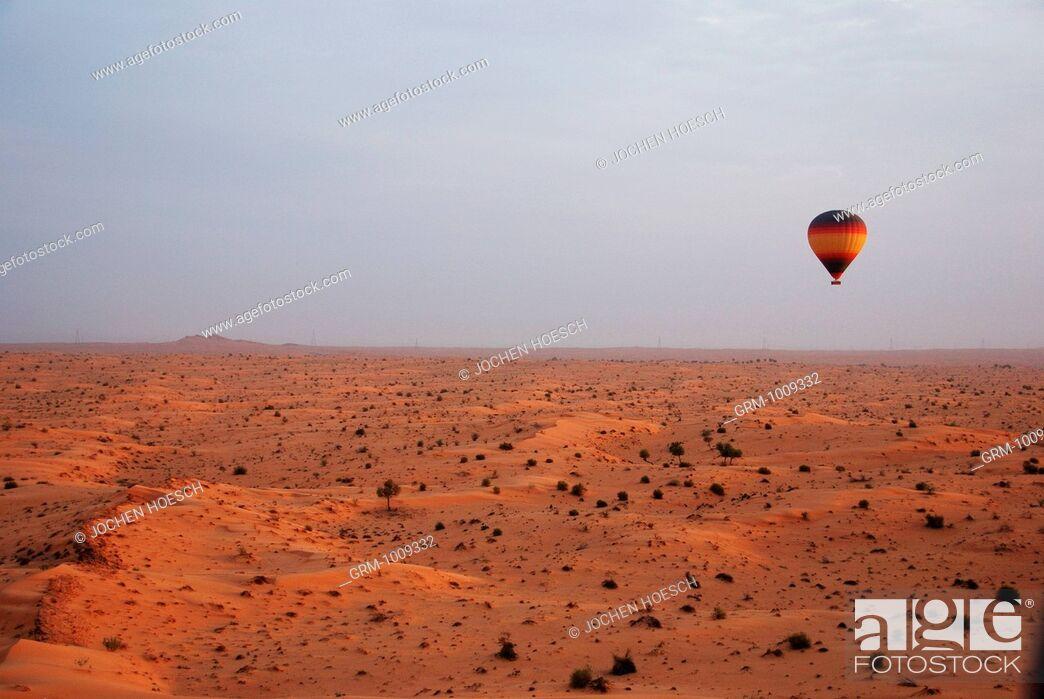 Stock Photo: Hot Air Balloon flying over the desert in Dubai, UAE.