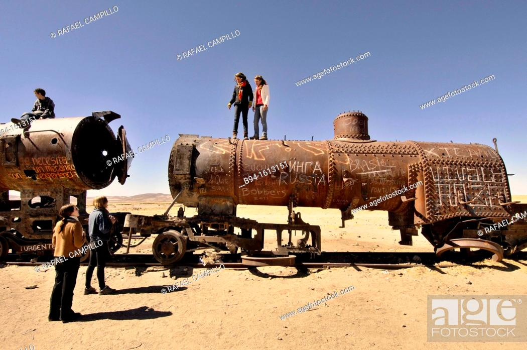Stock Photo: Train cemetery. It is 3 kilometers (1.9 mi) outside Uyuni, city in the southwest of Bolivia and is connected to it by the old train tracks. Bolivia.
