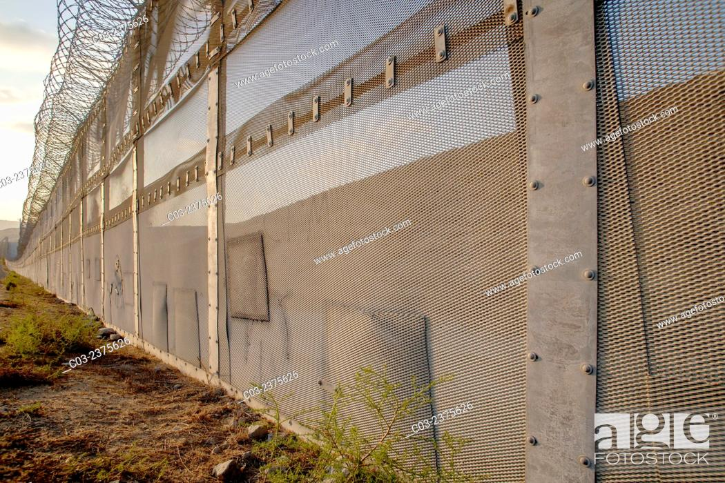 Stock Photo: Patched holes in the international fence on the U.S./Mexico border opposite the Colonia Libertad district of Tijuana, Mexico show places where illegal.