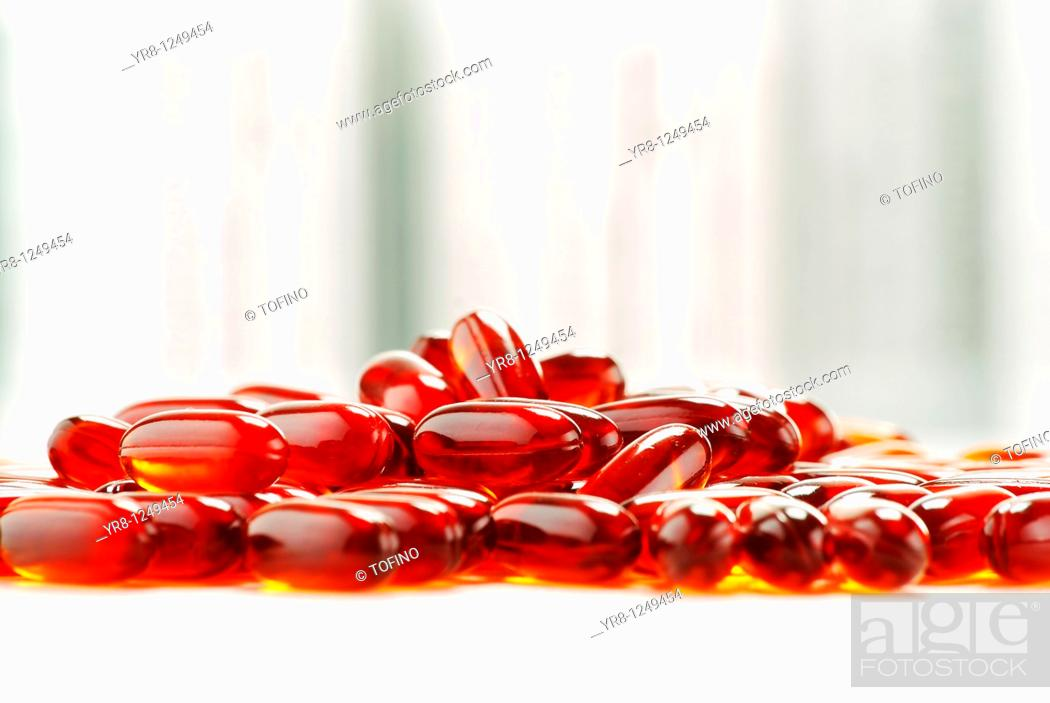 Stock Photo: Composition with dietary supplement capsules and containers.