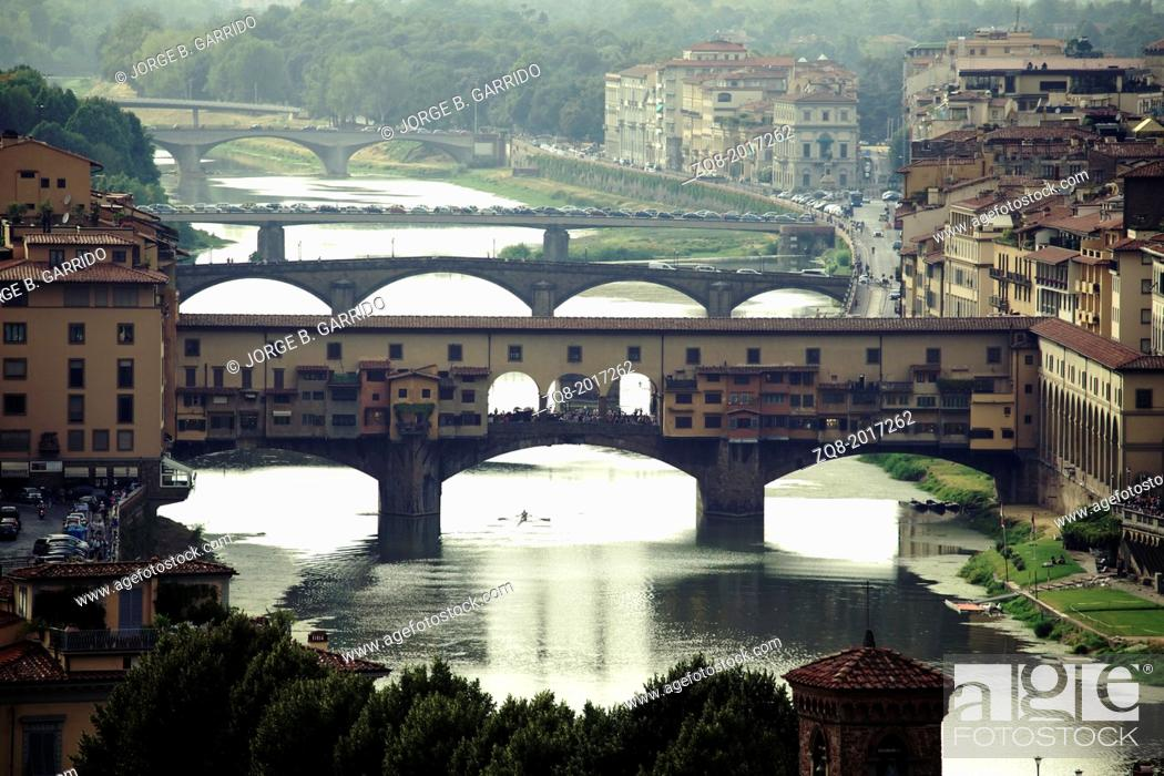 Stock Photo: Ponte Vecchio, Florence with reflections in the Arno River.