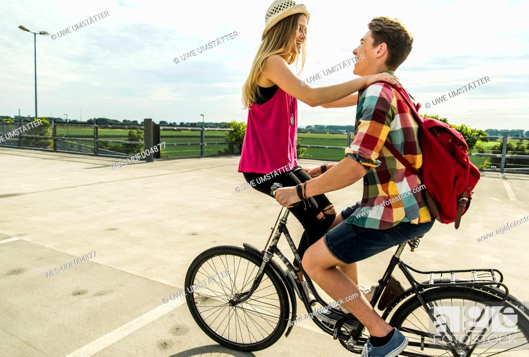 Stock Photo: Happy young couple together on a bicycle.