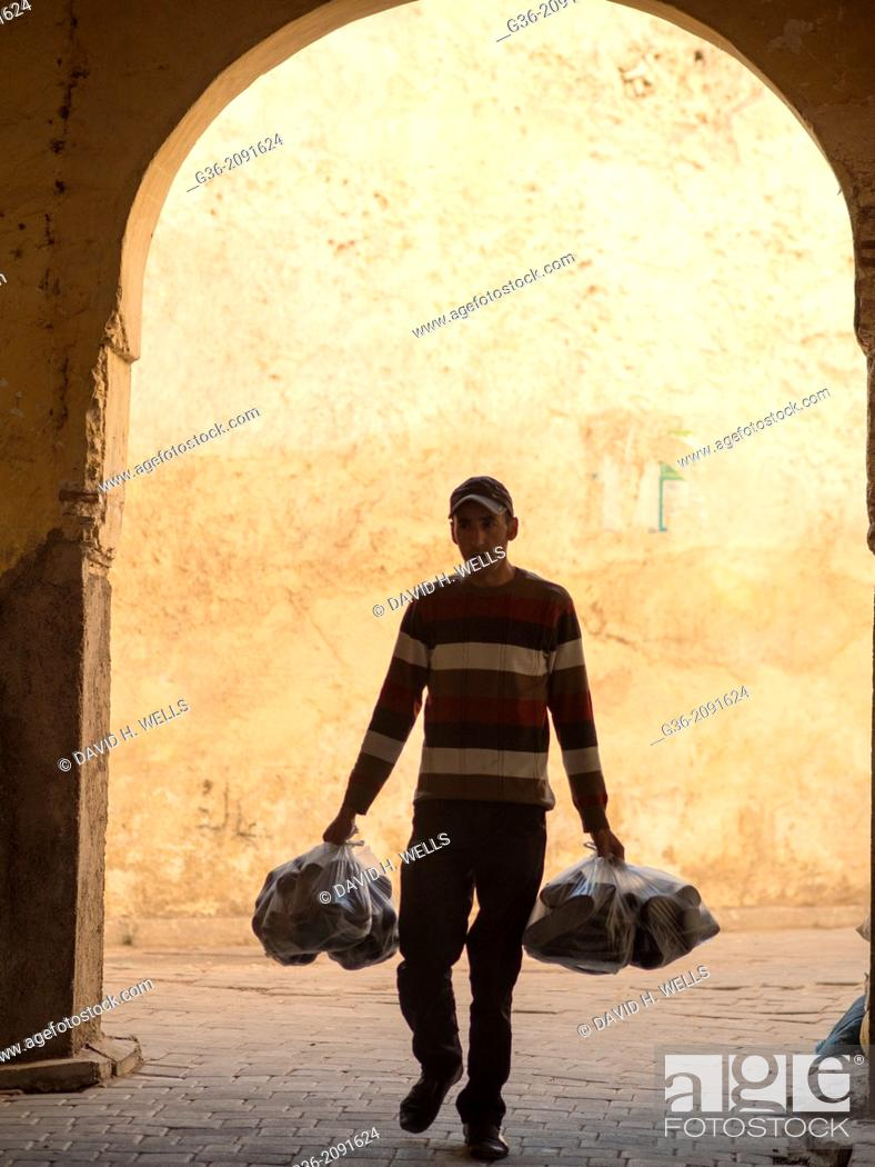 Stock Photo: People walking down the street in the medina in Fez, Morrocco.