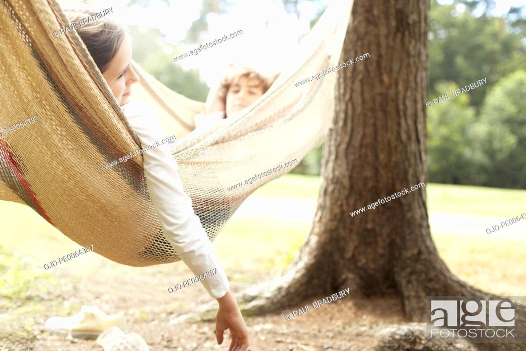 Stock Photo: Children laying in hammock.