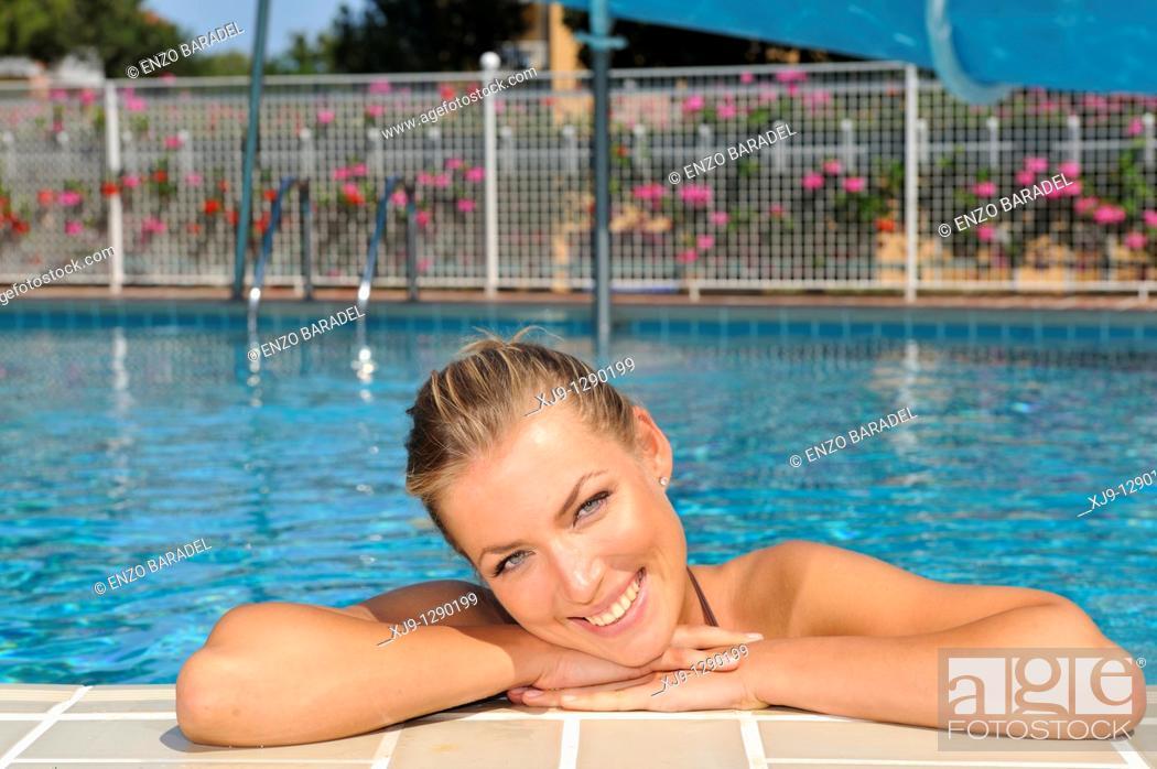 Stock Photo: Woman smile in swimmingpool. Lignano Sabbiadoro, Udine, Italy.