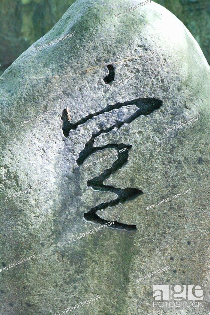 Stock Photo: Japanese symbol carved into stone, close-up.