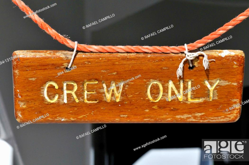 Stock Photo: Crew only sign in cruise ship.