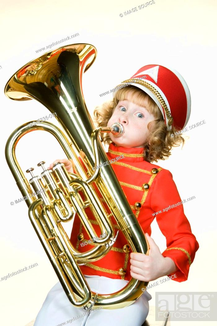 Stock Photo: Portrait of a girl playing the tuba.