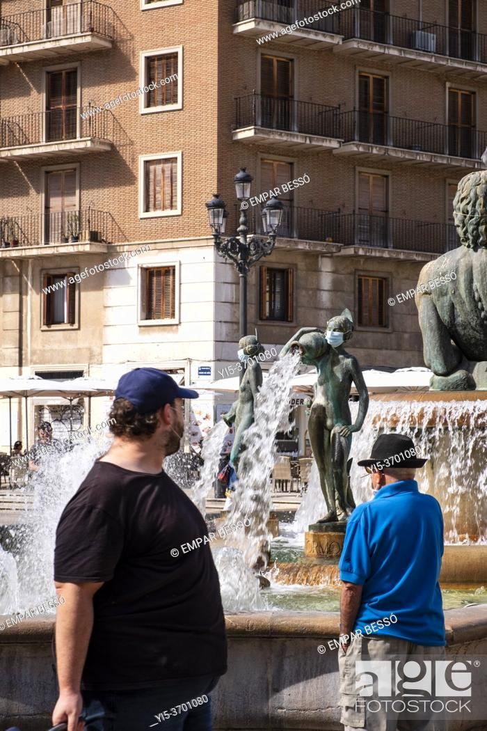Stock Photo: Statues with mask. Virgin Square. València. Spain. September 2020.