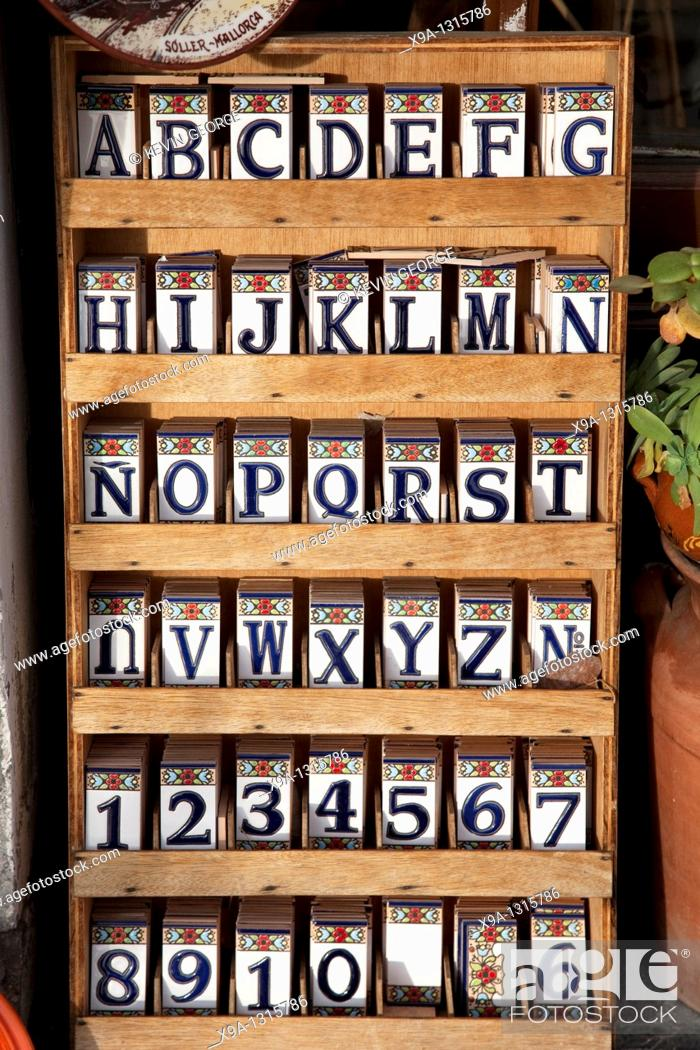 Stock Photo: Alphabet letters and numbers on painted tiles for sale in souvenir shop in Majorca, Spain.