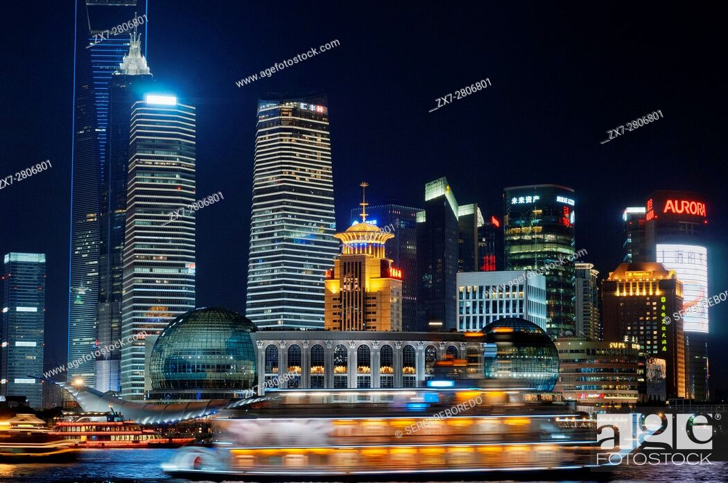 Stock Photo: Pudong Skyline, by night, Shanghai, China. Skyline of Pudong as seen from the Bund, with landmark Oriental Pearl tower and Jin Mao tower, Shanghai, China.