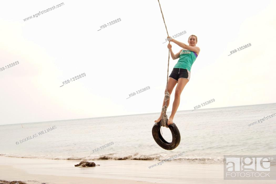 Stock Photo: teenage girl on holiday at the beach in the tropics.